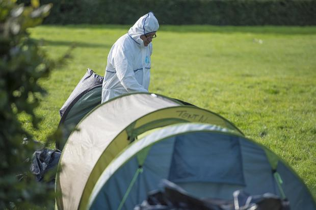 Forensic officers beside Mr Hourihane's tent at the scene of the fire and murder. Photo: Michael Mac Sweeney/Provision