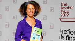British author Bernardine Evaristo poses with her book 'Girl, Woman, Other' during the photo call for the authors shortlisted for the 2019 Booker Prize for Fiction at Southbank Centre in London. Photo: TOLGA AKMEN/AFP via Getty Images