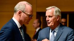 Tanaiste Simon Coveney talks with European Union's chief Brexit negotiator Michel Barnier during a meeting in Luxembourg (Photo by John THYS / AFP) (Photo by JOHN THYS/AFP via Getty Images)