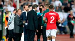 England manager Gareth Southgate (second left) and match referee Ivan Bebek (third right) during the UEFA Euro 2020 Qualifying match at the Vasil Levski National Stadium, Sofia, Bulgaria. Nick Potts/PA Wire