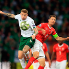 Ireland's James McClean and Switzerland's Stephan Lichtsteiner (right) battle for the ball during the UEFA Euro 2020 Qualifying match at the Stade de Geneve, Geneva. PA Photo. Picture date: Tuesday October 15, 2019. See PA story SOCCER Republic. Photo credit should read: Simon Cooper/PA Wire. RESTRICTIONS: Editorial use only, No commercial use without prior permission.
