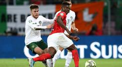 Ireland's Aaron Connolly in action against Switzerland's Breel Embolo. Photo: Reuters/Denis Balibouse