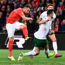 Switzerland's forward Haris Seferovic (l) scores his team's first goal during the Euro 2020 qualifier against Ireland at the Stade de Geneve stadium