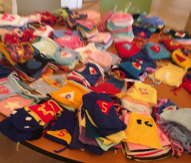 Some capes that were knitted for children in the Rotunda