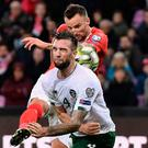 Switzerland's forward Haris Seferovic (back) kicks a ball behind Ireland's defender Shane Duffy during the Euro 2020 Group D qualification football match between Switzerland vs Ireland at the Stade de Geneve stadium in Geneva on October 15, 2019. (Photo by FABRICE COFFRINI/AFP via Getty Images)