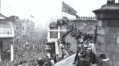 Time before change: A Union flag flies over Trinity College Dublin in 1919 as troops take part in a victory parade after World War I