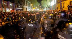 Protesters clash with Catalan regional police officers during a protest in front of the Spanish government delegation building in Barcelona yesterday. Photo: AFP via Getty Images
