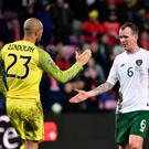 Ireland's goalkeeper Darren Randolph and Ireland's midfielder Glenn Whelan after the Euro 2020 qualifier at the Stade de Geneve stadium on October 15, 2019 in Geneva.