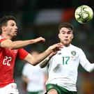 Soccer Football - Euro 2020 Qualifier - Group D - Switzerland v Republic of Ireland - Stade de Geneve, Geneva, Switzerland - October 15, 2019 Republic of Ireland's Aaron Connolly in action with Switzerland's Fabian Schar REUTERS/Denis Balibouse