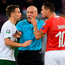 Referee Szymon Marciniak attempts to separate Seamus Coleman and Switzerland's Granit Xhaka. Photo: Sportsfile