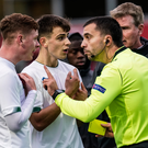 Kameron Ledwidge (L) and Jayson Molumby with head coach Stephen Kenny (R) remonstrate to referee Dumitri Muntean. Photo: Sportsfile