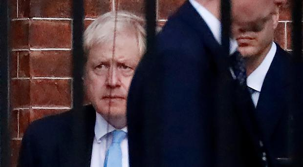 Britain's Prime Minister Boris Johnson (L) leaves from the rear of 10 Downing Street in central London on October 16, 2019. Photo: TOLGA AKMEN/AFP via Getty Images