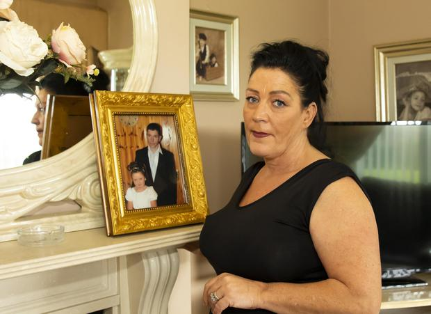 Heartache: Elizabeth Cash, with a photograph of her late brother Paddy Connors. Photo: Mary Browne