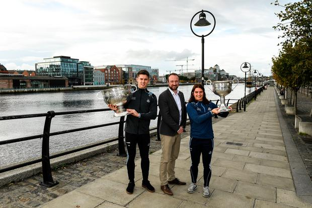 John Gillick, AIG Head of Sponsorship, with Dublin footballers Davy Byrne and Niamh Collins on a visit to AIG Insurance's head office. Pic: Matt Browne