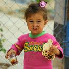 Refugee: A child holds bread in the Mabrouka camp, near Ras al-Ain, Syria. Photo: Getty