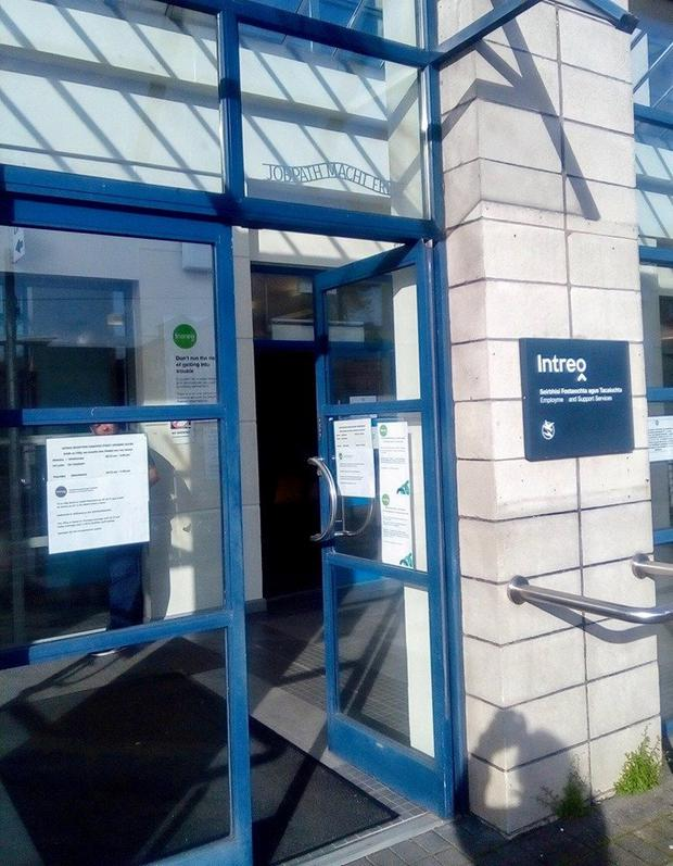 """Gardai have been alerted to an """"extremely offensive"""" sign, reminiscent of the Nazi era, placed at a social welfare office in Co Cork."""
