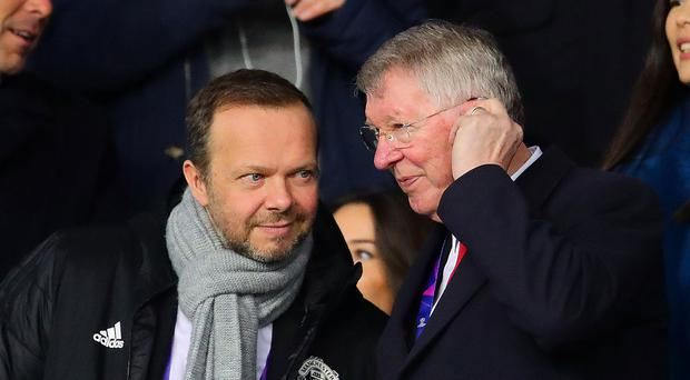 Manchester United chief executive Ed Woodward chats with Alex Ferguson during their Champions League clash with Paris Saint Germain earlier this year. Photo: Chris Brunskill/Fantasista