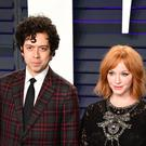 Mad Men star Christina Hendricks has announced she has split from her husband of 10 years (Ian West/PA)