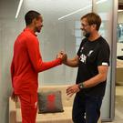 Deal done: Joel Matip is congratulated by Liverpool manager Jurgen Klopp after the defender signed a contract extension at Melwood yesterday. Photo: Andrew Powell/Liverpool FC via Getty Images