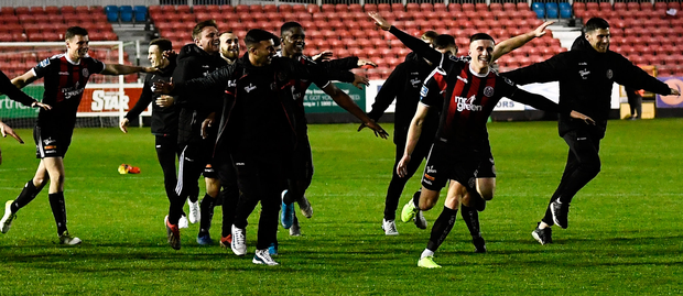 Bohemians players celebrate gaining the point needed to make it into the Europa League qualifying rounds
