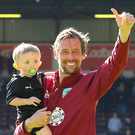 Peter Crouch waves to fans after his final game as a professional with Burnley against Arsenal last May. Photo: Getty Images