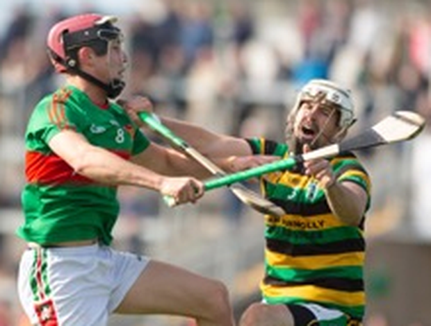 Oisín Murphy in action for the club against Dave Kenny of Belmont