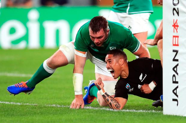 New Zealand's Aaron Smith celebrates scoring his side's first try during the 2019 Rugby World Cup Quarter Final match at Tokyo Stadium. Adam Davy/PA Wire.