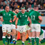 Ireland players, including Rhys Ruddock, left, and Josh van der Flier, react after New Zealand scored their side's sixth try