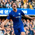 Chelsea's Spanish defender Marcos Alonso celebrates after scoring the opening goal of the English Premier League football match between Chelsea and Newcastle at Stamford Bridge in London on October 19, 2019. (Photo by Oliver GREENWOOD / AFP)
