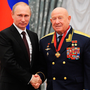 Comrades: Former cosmonaut Alexei Leonov, the first man to walk in space, with Russian President Vladimir Putin in 2013. Photo: Mikhail Klimentyev, Sputnik, Kremlin Pool Photo via AP
