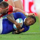 France's Virimi Vakatawa, right, scores a try against Wales' Wyn Jones during the Rugby World Cup quarterfinal match at Oita Stadium in Oita, Japan, Sunday, Oct. 20, 2019. (AP Photo/Christophe Ena)