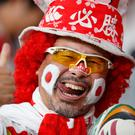 Japan fan poses for a picture before the match. REUTERS/Matthew Childs