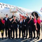 Qantas Group CEO Alan Joyce (C) and crew celebrating in front of a Qantas Boeing 787 Dreamliner plane after arriving at Sydney international airport after completing a non-stop test flight from New York (Photo by DAVID GRAY/QANTAS/AFP via Getty Images)