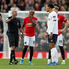 Soccer Football - Premier League - Manchester United v Liverpool - Old Trafford, Manchester, Britain - October 20, 2019 Referee Martin Atkinson gestures as Liverpool's Virgil van Dijk looks on. REUTERS/Russell Cheyne