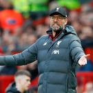 Liverpool manager Jurgen Klopp gestures on the touchline during the Premier League match at Old Trafford, Manchester. Sunday October 20, 2019. Martin Rickett/PA Wire.