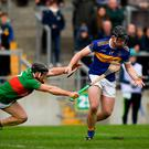 At full stretch: Sean Dolan of St Rynagh's (right) in action against Birr's Sean Ryan during the Offaly SHC final at O'Connor Park. Photo: Harry Murphy/Sportsfile