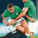 Substitute Jordan Larmour is tackled by Scott Barrett during Ireland's heavy defeat against New Zealand. Photo: Stu Forster/Getty