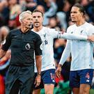 Liverpool players Jordan Henderson and Virgil van Dijk voice their displeasure to referee Martin Atkinson after Marcus Rashford opened the scoring for Manchester United at Old Trafford yesterday. Photo: Oli Scarff/AFP via Getty Images