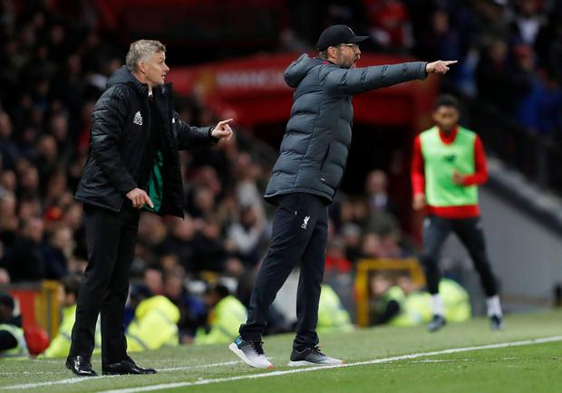 Manchester United manager Ole Gunnar Solskjaer and Liverpool manager Jurgen Klopp blast out instructions from the sidelines. Photo: REUTERS/Russell Cheyne