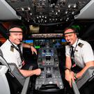 In this handout photo from Qantas, captain Sean Golding (L) and first officer Jeremy Sutherland are pictured in the cockpit of a Qantas Boeing 787 Dreamliner plane in New York before completing a non-stop test flight from New York to Sydney. Photo: QANTAS/AFP via Getty Images