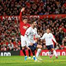 Adam Lallana finishes the ball to the Manchester United net to earn a point for Liverpool at Old Trafford. Photo: Russell Cheyne/Reuters