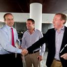 Fianna Fáil leader Micheál Martin pictured with Deputy Timmy Dooley and Deputy Niall Collins in 2011. Mr Martin took action yesterday to limit the fall-out of the 'phantom votes' affair involving the two TDs. PHOTO: MARK CONDREN