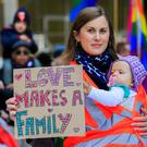 Message: Ranae Von Meding and her daughter Arya (9 months), from the city centre, at the protest in Dublin. Photo: Gareth Chaney, Collins
