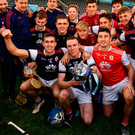 Cuala captain Colm Cronin celebrating with team-mates after Sunday's victory. Photo: Ray McManus/Sportsfile