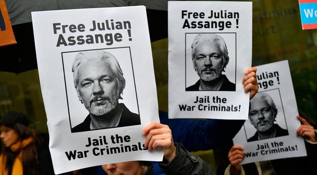 Protest: Banners calling for WikiLeaks founder Julian Assange to be freed yesterday. Photo: Getty Images