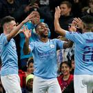 Soccer Football - Champions League - Group C - Manchester City v Atalanta - Etihad Stadium, Manchester, Britain - October 22, 2019 Manchester City's Raheem Sterling celebrates scoring their fifth goal and completing his hat-trick with Phil Foden and Riyad Mahrez REUTERS/Andrew Yates