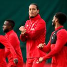 Virgil van Dijk chats with Joe Gomez during a Liverpool training session ahead of their Champions League group E match against KRC Genk. Photo: Jan Kruger/Getty Images