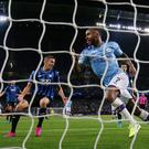 Raheem Sterling puts away Manchester City's fifth goal of the night, completing his hat-trick. Photo: Action Images via Reuters/Jason Cairnduff