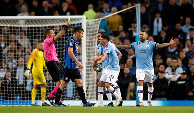 Phil Foden is shown a second yellow card and sent off by referee Orel Grinfeld. Photo: Martin Rickett/PA Wire