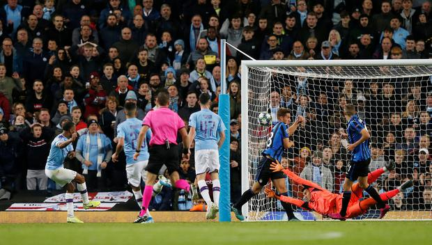 Raheem Sterling gets City's third. Photo: REUTERS/Andrew Yates